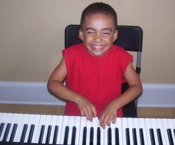 Happy Kid Playing the Piano
